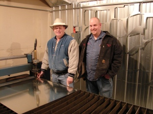 Joe and Adam Wadas pose with a new plasma cutter purchase with local sales tax funds